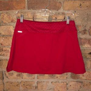 Red hot mini tennis skirt